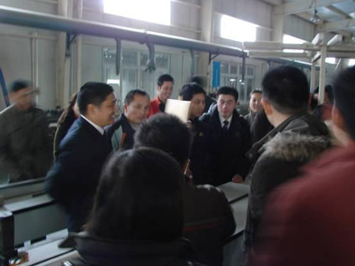 Company Chairman Mr.huang at the scene on the production process